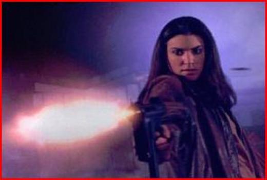 Charlie Roadtrap (Tara Bilkins) opens fire.