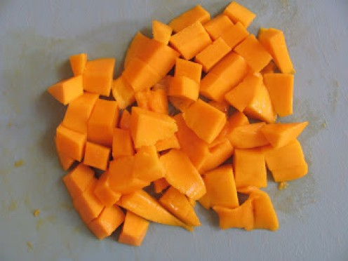 1. Chop washed and peeled mangoes into cubes.