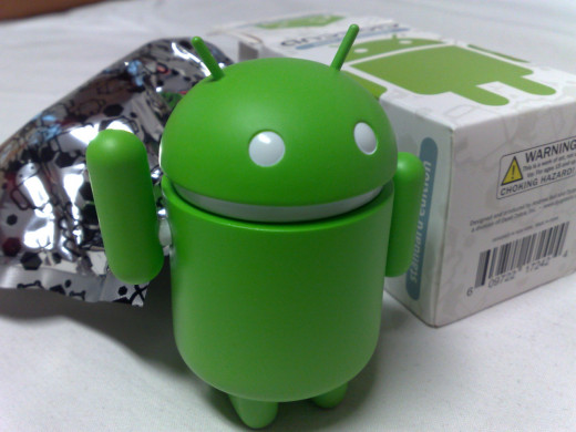 Android Figure next to the packaging