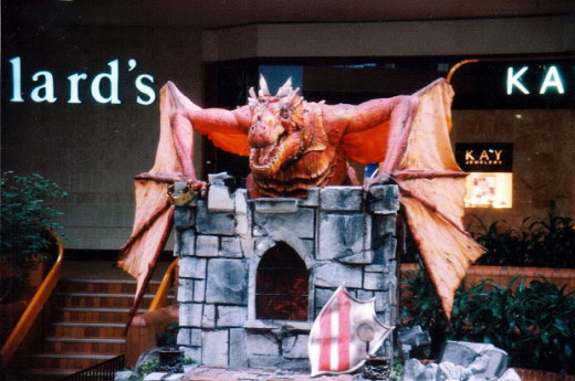 A statue of a Dragon guarding an entrance.