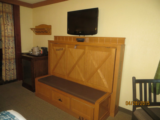 This little piece of furniture housed a single bed, sort of in the style of a murphy bed.