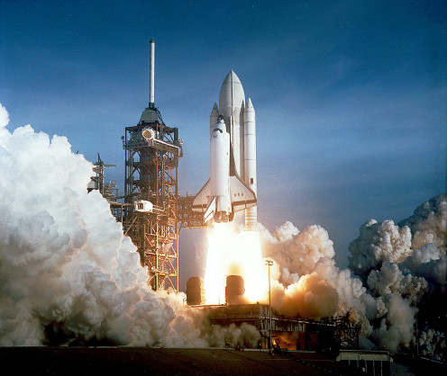 Space Shuttle Atlantis as it blast off at full power.