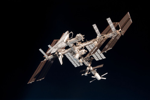 Shuttle docked with completed International Space Station.