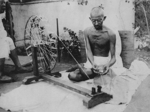 The Indian political campaigner Mahatma Gandhi pictured spinning yarn.  Gandhi's ideas of non-violent action were an enormous influence on King, who used them to great effect in the American Civil Rights Movement.