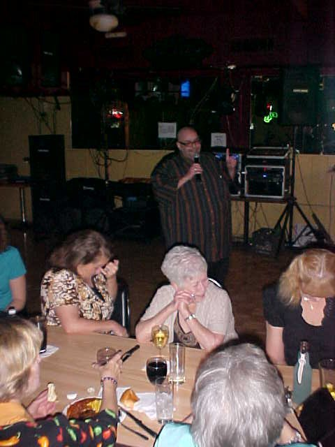 "The late Morris Katzoff is on a dance floor substituting for ""the stage."" If you're in a bar you have to play to seats that are turned away from you. Trick is to keep 'em focused with eye contact and you can because you're right there at eye level."