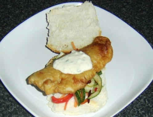 Fish fritter and salad sandwich with tartar sauce