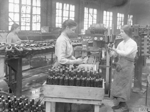 Women labeling lager bottles in Cheshire, England
