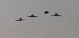 A flight of F-4 Phantom IIs over the Washington Mall during the Desert Storm Victory Parade, June 1991.