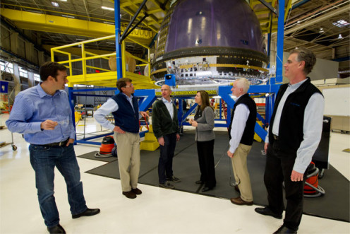 Jeff Bezos with his staff around a Blue Origin capsule.