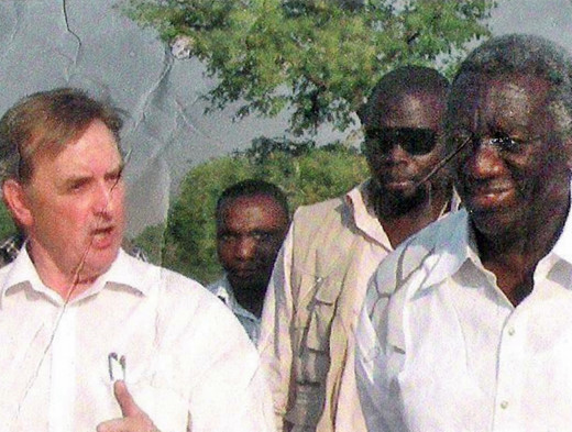 My brother Eric, on the left, with clients on one of his civil engineering contracts overseas.