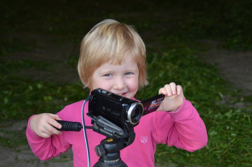 A child holding a video camera