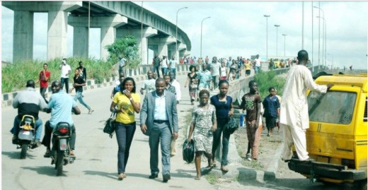 People walking when commercial buses or taxis are unavailable
