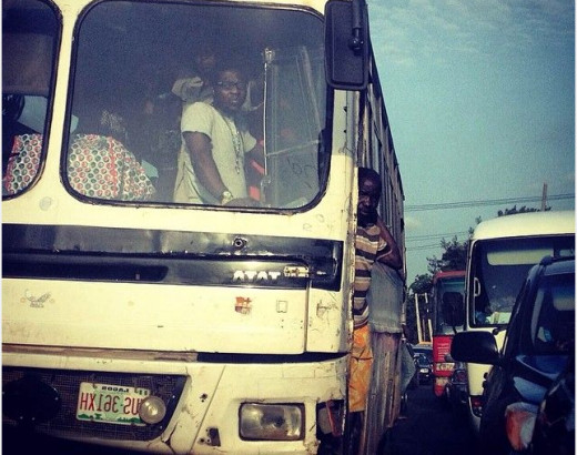 People standing in buses due to lack of space.