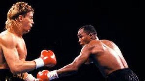 Sugar Ray knocked out Donny Lalonde to win the super middleweight and light heavyweight world titles.