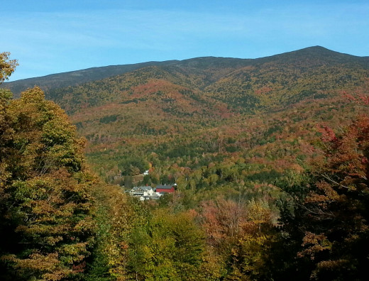 From the upper slopes of the mountain, the small tourist settlement in the valley seems like a tiny island in a sea of fall color.