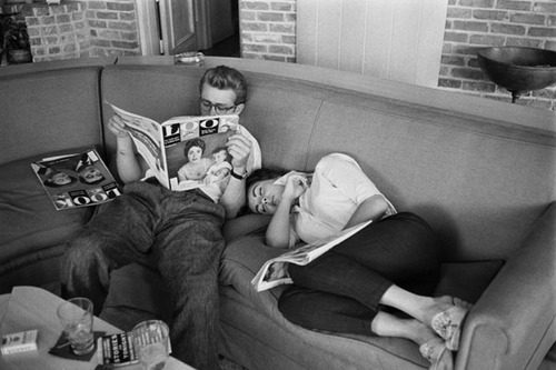 "James Dean relaxes with Elizabeth Taylor between takes on the set of ""Giant"" (1956)."