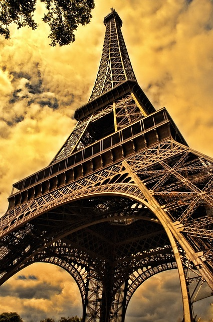 The Eiffel Tower in Paris.  Paris is the third most popular tourist destination worldwide and home to the most visited art museum in the world, the Louvre.  It also boasts the 12th Century Notre Dame Cathedral.