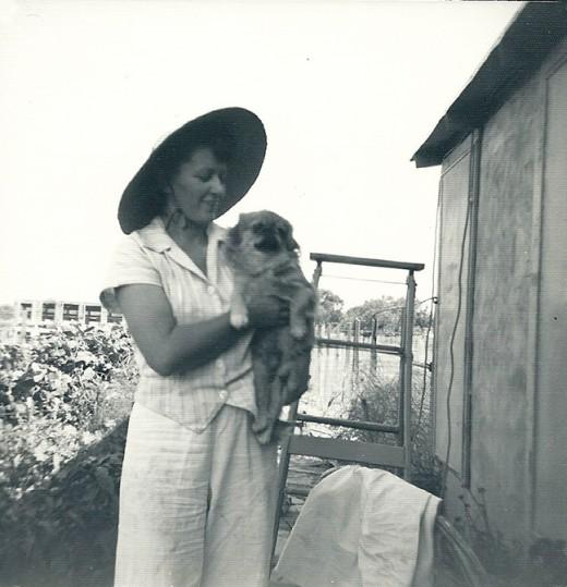 Grandma with her Pekinese puppy.