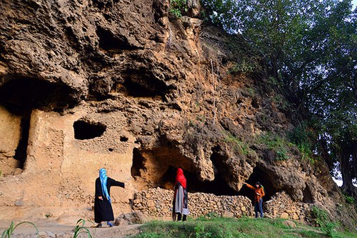 At the foothills of the Margalla Hills on the southwest of Islamabad lie, silently, the caves with Buddhist relics in the centuries-old Shah Allah Ditta village