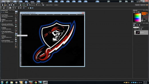 Cut this school logo out of this black background and paste it onto another one using Paint Shop Pro