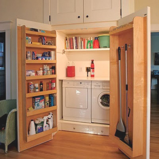 Clever deep shelving in laundry cabinet doors can be used to store equipment and laundry supplies