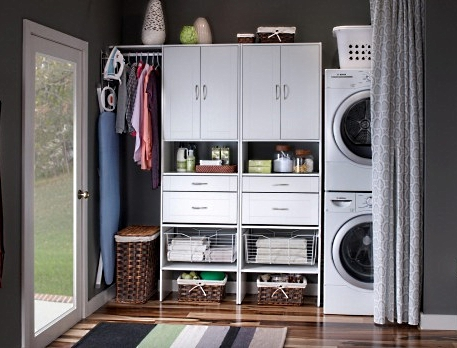 Laundry cabinets can be combined with storage of outdoor clothing and footwear, saving space for other purposes.