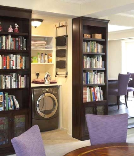 With appropriate design mini laundry cabinets may even be installed in living rooms. Using book shelves and heavy doors hides the equipment away and reduces noise.