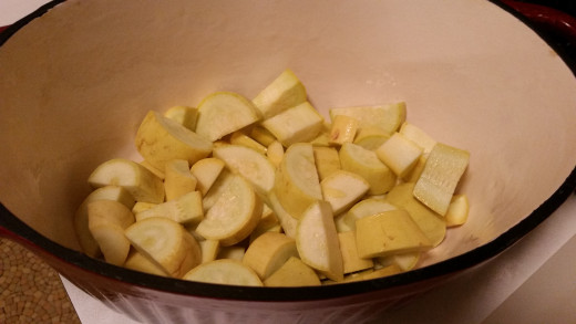 Cut your yellow squash into thick half-moon size pieces.
