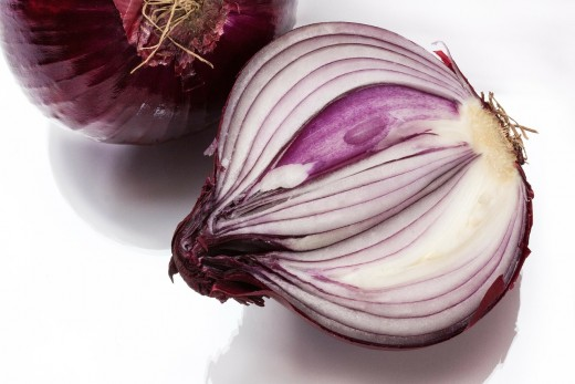 Red onions, one cut in half vertically