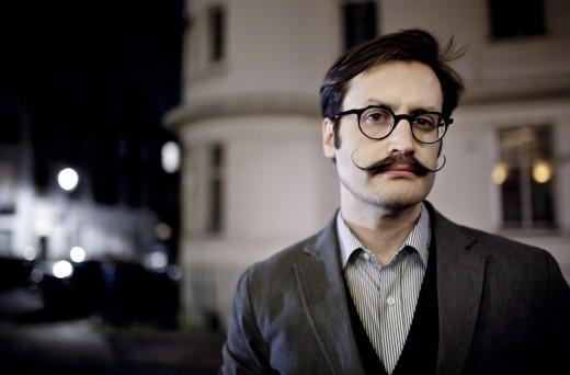 This handlebar mustache.