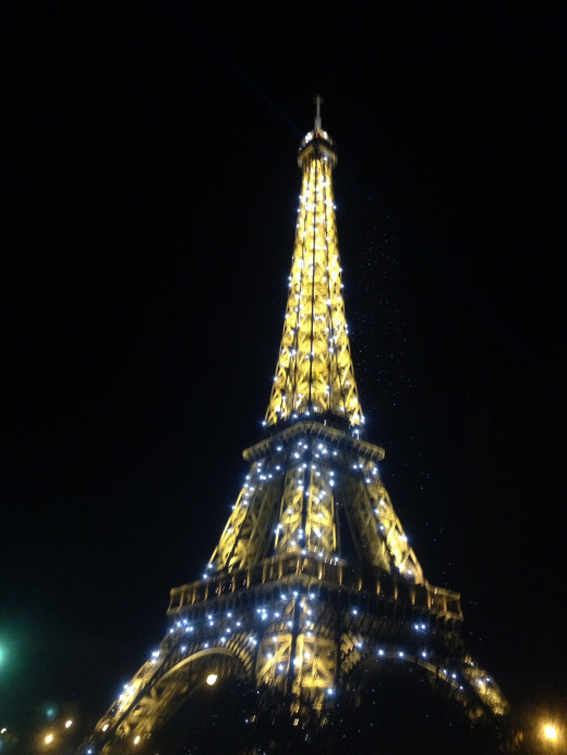 The Eiffel Tower explodes with shimmering splendor as our tired eyes get wider and wider.