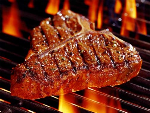 T-bone steak grilling to a perfect taste.