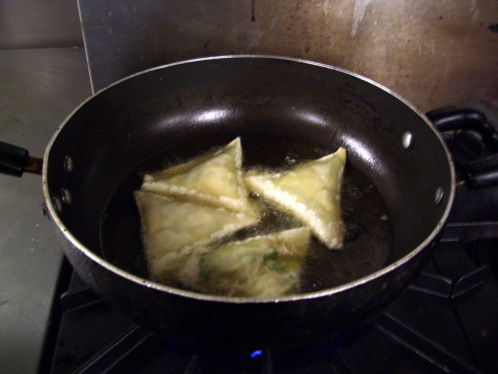 Frying the samosas on a slow flame