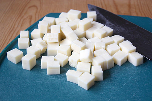 Slice the mozzarella ½ inch thick  to form cubes.