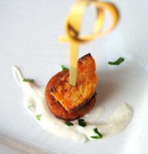 When sweet potatoes and sausages have finished cooking, assemble the skewers: Poke a toothpick through the center of a sweet potato piece, then a sausage piece, then transfer to a serving platter