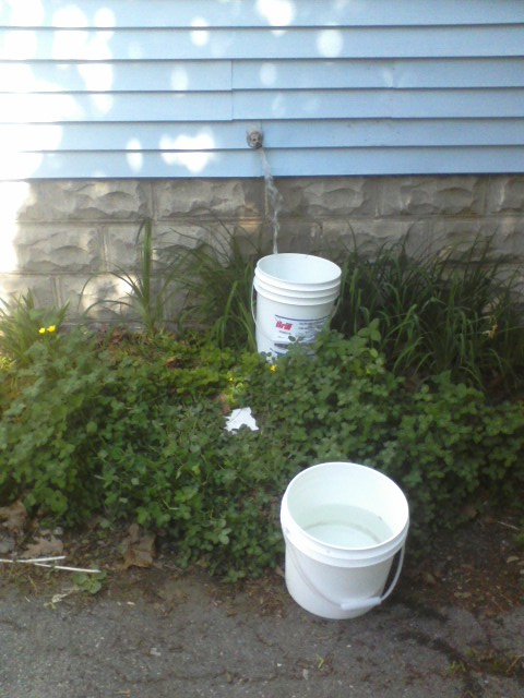 Fill bucket under the spigot, carry bucket goes to the garden and comes back.