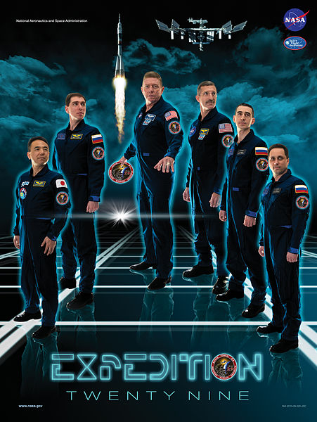 ISS Expedition 29 Astronauts posed as Tron: Legacy explorers for their official poster during Autumn 2011.