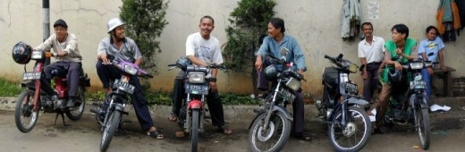 Motorcycle taxi drivers on standby