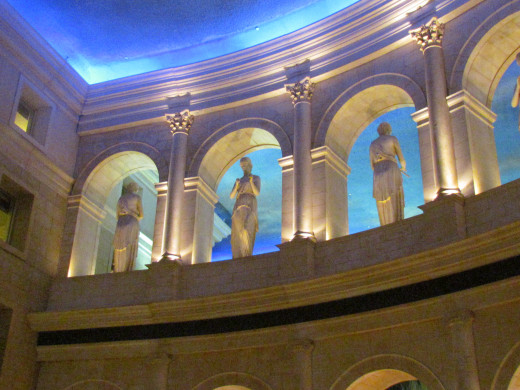 The foyer of Caesars in Atlantic City has statuesque figures looking down from the resplendent ceiling.