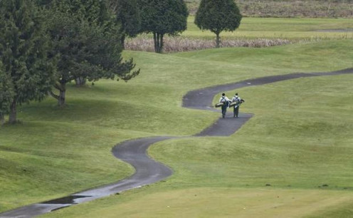 The Long Goodbye: Two golfers walk towards a green at Sumner Meadows in 2012.