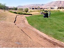 Out of bounds turf being torn up and replaced at a course outside of Las Vegas.