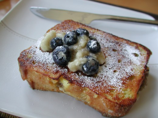 French Toast served with banana pieces and blueberries