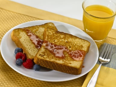 French toast served with Mango Cranberry syrup and orange juice