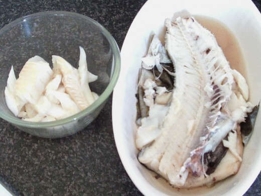 Flesh is picked from first side of poached codling
