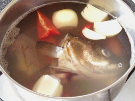 Cod fish stock ingredients are added to pot
