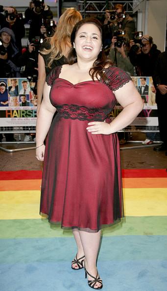 Nikki Blonsky wearing a red dress