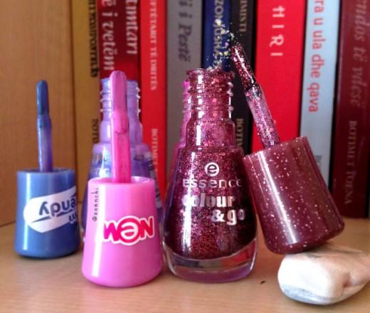 Purple glittery Essence nail polish.