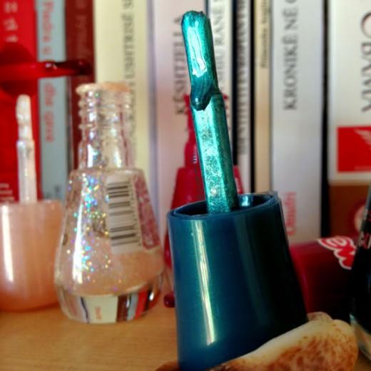 Closeup of blue nail polish brush.