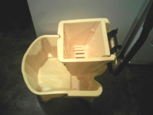 I bought a sturdy mop bucket with wringer just to use for laundry.