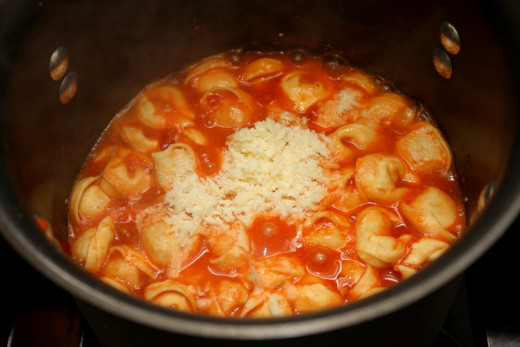 Add Greek yogurt, grated cheese and tortellini to the puree and stir.  Simmer on low heat for 10 minutes.